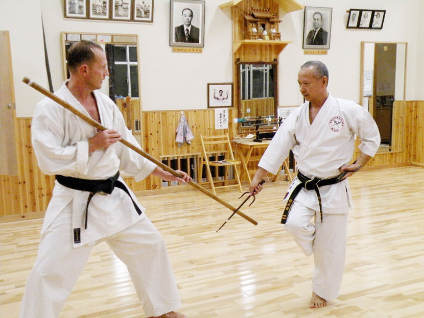 Karate Sai (traditional Okinawan weapon) and Karate Bo (Traditional Karate Stick)